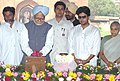 The Prime Minister, Dr. Manmohan Singh paying floral tributes to Col. G. S. Dhillon, at a function at Red Fort in Delhi on March 30, 2006. The Chief Minister of Delhi, Smt. Sheila Dikshit is also seen.jpg
