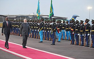 The RDF providing a guard of honour. The Prime Minister, Shri Narendra Modi inspecting the Guard of Honour, on his arrival, at Kigali International Airport, Rwanda on July 23, 2018. The President of Rwanda, Mr. Paul Kagame is also seen.JPG