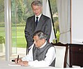 The Union Minister for External Affairs, Shri S.M. Krishna writing condolence message at Japanese Embassy on loss of lives in Japan, in New Delhi on March 18, 2011.jpg