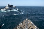 The amphibious dock landing ship USS Carter Hall (LSD 50), foreground, approaches the dry cargo and ammunition ship USNS Cesar Chavez (T-AKE 14) for a replenishment at sea in the Gulf of Aden Aug. 20, 2013 130820-N-NB538-054.jpg