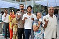 The voters showing their voter identity cards, at a polling booth during the 3rd Phase of General Elections-2014, in New Delhi on April 10, 2014.jpg