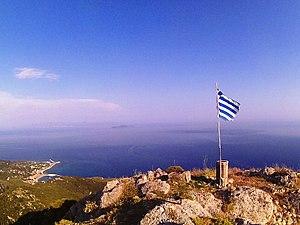 Flag of Greece - Greek flag on the top of Mount Imerovigli, Othonoi
