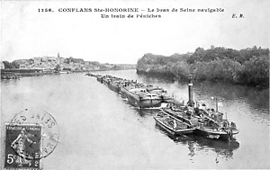 "Chain boat navigation - Postcard showing a chain steamer on river Seine in France. The caption reads ""Conflans Sainte-Honorine – An arm of the Seine waterway. A train of barges.""."