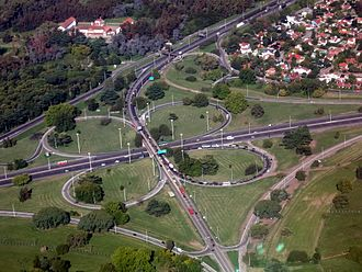 Ezeiza, Buenos Aires - Cloverleaf interchange between the Ricchieri Freeway and the Ezeiza-Cañuelas Freeway, near Pistarini International Airport. The Barrio Uno subdivision is visible on the upper right-hand corner.