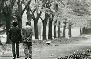 Quinta de Olivos - President Menem and former President Alfonsin walk together into the residence gardens after the Olivos Pact