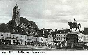 Ban Jelačić Square - The square in an 1880 postcard showing the statue facing north, peasant stalls, and the Zagreb Cathedral before the 1880 earthquake