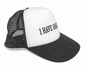 """Trucker hat - A trucker hat bearing the humorous warning """"I have issues"""""""
