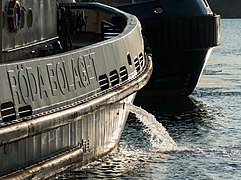 Tugboat Boss discharging ballast water before departure.jpg