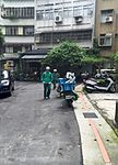 Two Chunghwa Post Mail Carriers Back to Motorcycles after Send Mail 20160630.jpg