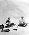 Two Indian bookbinders; one trimming page edges in a press, Wellcome L0000900.jpg