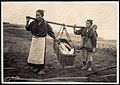 Two Japanese women carrying a basket of fish - Bringing in the Catch (1915 by Elstner Hilton).jpg