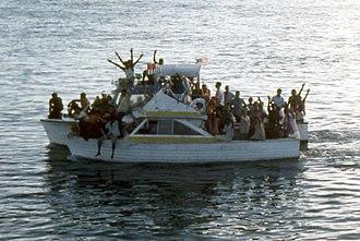 Mariel boatlift - Two overloaded boats in Key West Harbor during the Mariel Boatlift