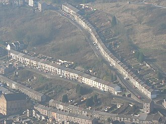 Terraced houses in the United Kingdom - Many terraced houses were built in the Rhondda in the mid to late 19th century, as they could accommodate migrants within the mountainous landscape.