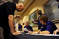 U.S. Air Force Senior Master Sgt. Kavina Agnew, right, a first sergeant assigned to Tinker Air Force Base, Okla., works at the registration table during the 2012 United States Air Force First Sergeant Leadership 120810-F-JI727-039.jpg