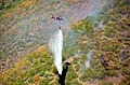 U.S. Airmen with the 129th Rescue Wing, California Air National Guard drop water on the Rim Fire near Yosemite, Calif., Aug. 26, 2013 130826-Z-ZZ999-014.jpg