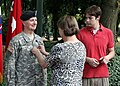 U.S. Army Col. Charles R. Bailey, chaplain, is promoted to brigadier general by his wife, Karen R. Bailey, as their son looks on at the Eddy house green, Campbell Barracks, Heidelberg, Germany, July 7, 2011 110707-A-HQ726-001.jpg