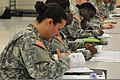 U.S. Army Sgt. Sabrina Gonzales, financial management noncommissioned officer, looks over an information packet during a training exercise at the Lanny J. Wallace Army Reserve Training Center in Wichita, Kan 130608-A-BE524-400.jpg