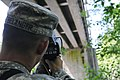 U.S. Army Spc. William Belanger with the 610th Engineer Support Company uses a laser range finder to gather and record data on the Nisqually River Bridge while training with the new ENFIRE system at Joint Base 130605-A-FF538-102.jpg