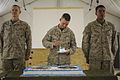 U.S. Marine Corps Lt. Col. Corey Collier, center, the commanding officer of the 1st Battalion, 9th Marine Regiment, eats a piece of birthday cake during a cake-cutting ceremony Nov. 11, 2013, at Camp 131111-M-WA264-006.jpg