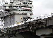 The USS Abraham Lincoln returning to port carrying its Mission Accomplished banner