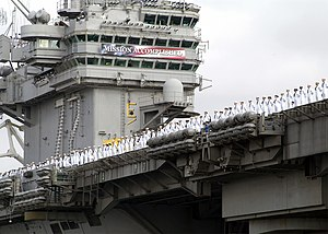 USS Abraham Lincoln (CVN-72) - Abraham Lincoln returning to port carrying its Mission Accomplished banner, 2 May 2003.