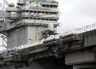2003 in Iraq - The USS Abraham Lincoln returning to port carrying its Mission Accomplished banner