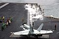 US Navy 030331-N-9228K-019 An Aviation Boatswain's Mate directs an F-A-18E Super Hornet onto the flight line in preparation for launch from one of four steam-powered catapults on the flight deck of USS Abraham Lincoln (CVN 72).jpg
