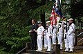 US Navy 030525-N-2420K-004 Command Master Chief William Lowmon, assigned to Fleet Activities Sasebo, Japan, provides an invocation honoring fallen comrades during a Memorial Day ceremony at Soto Dam.jpg