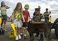 "US Navy 030907-N-5783F-086 Children admire ""Tara,"" a working dog assigned to the Security Force K-9 Unit during the Naval Air Station (NAS) Oceana Regional Air Show.jpg"