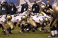 US Navy 031206-N-6157F-001 Quarterback Craig Candeto calls signals before getting the snap from his center.jpg