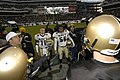 US Navy 031206-N-6157F-507 U.S. Naval Academy football team captains Craig Candeto (11) and Eddie Carthan (56) watch as a referee flips a coin to decide which team will take possession of the ball.jpg