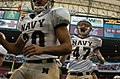 US Navy 031230-N-2653P-133 Navy safeties Paul Clarkson and Clay Carter charge on the field prior to the Naval Academy's game with Texas Tech in the EV1.Net Houston Bowl.jpg