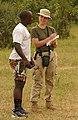 US Navy 040111-N-3236B-002 Journalist 2nd Class Andrea Lahey assigned to the amphibious transport dock USS Germantown (LSD 42) interviews the coach of a local Kenyan Soccer team.jpg