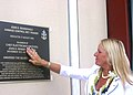 US Navy 040817-N-5539C-004 Mary Kay Rendernick, daughter of the World War II (WWII) hero Chief Electrician's Mate John D. Rendernick reacts to the unveiling of the plaque bearing her father's name.jpg