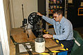 US Navy 040907-N-8770A-008 Aircrew Survival Equipmentman 2nd Class Joshua Houser, of Fort Wayne, Ind., uses the class 7 sewing machine to sew a parachute harness.jpg