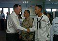 US Navy 050219-N-4267W-025 Former President George H. W. Bush shakes the hand of Builder 2nd Class Donald Wintersteen.jpg