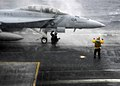 US Navy 060330-N-7981E-059 Flight deck personnel work to ready an F-A-18F Super Hornet assigned to the Fighting Vigilantes of Strike Fighter Squadron One Five One (VFA-151) for take-off.jpg