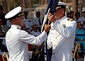US Navy 060524-N-0553R-002 Commander, Construction Battalion Center, 20th Seabee Readiness Group, Capt. George E. Eichert transfers the command colors to on-coming skipper Capt. H.V. Dobson during a change of command ceremony.jpg