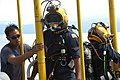 US Navy 060606-N-4205W-009 Master Sgt. David Ling from the Republic of Singapore Navy (RSN) stage handles Gunner's Mate 2nd Class Brian Zenoni and Lt. Chan Tse Chi Grace, RSN, after they conducted a dive.jpg