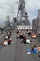 US Navy 060609-N-2456S-031 Sailors perform sit-ups as part of their physical training (PT) while underway aboard the guided-missile cruiser USS Monterey (CG 61).jpg