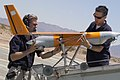 US Navy 060619-M-8788S-003 Boeing Company Advanced Tactical Systems Engineers Mark LaVille and Kris Kokkely, mount an Unmanned Aerial Vehicle (UAV) called Scan Eagle.jpg