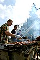 US Navy 061213-N-9689V-005 Chiefs assigned to the amphibious assault ship USS Boxer (LHD 4) grill hamburgers during a steel beach picnic celebrating the halfway point of their deployment.jpg