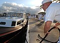 US Navy 070503-N-4965F-004 Engineman 1st Class Joshua Schultz, assigned to Commander, Navy Region Hawaii barge crew, secures a line while mooring at Merry Point Landing.jpg