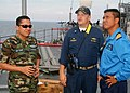 US Navy 070709-N-0120A-029 Cmdr. David L. Bossert, dock landing ship USS Harpers Ferry (LSD 49) commanding officer, discusses the ship's satellite communication capabilities with a Royal Malaysian Air Force officer and a.jpg