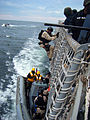 US Navy 090611-N-5624R-002 Members of the visit, board, search and seizure team from the guided-missile destroyer USS Forrest Sherman (DDG 98) return to Forrest Sherman.jpg