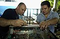 US Navy 090624-F-7923S-017 Hospital Corpsman 1st Class Byron Martin, a bio-medical repair technician aboard the Military Sealift Command hospital ship USNS Comfort (T-AH 20), and Rene Garcia, from the El Salvador Ministry of He.jpg