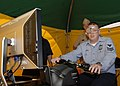 US Navy 090925-N-9520G-044 Culinary Specialist 1st Class Ken Batten, from Chesterfield, Va., operates a motorcycle simulator using training goggles designed to mimic what an alcohol-impaired driver would see.jpg