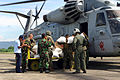 US Navy 091010-M-4689B-009 ndonesian service members and U.S. Marines load bundles of rice into a CH-53E Super Stallion helicopter.jpg