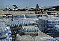 US Navy 100128-N-5345W-098 Pallets of humanitarian aid and bottled water are lined up in a staging area just off the tarmac of Aerodome de Jacmel, an airport in Port-au-Prince.jpg