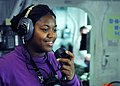 US Navy 100206-N-2218S-027 Aviation Boatswain's Mate (Fuel) 3rd Class Lamonica Holt directs the movements of the flight deck refueling team with a sound powered phone aboard the amphibious assault ship USS Essex (LHD 2).jpg